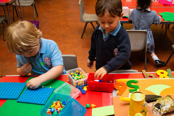 Nursery children  with a table top activity